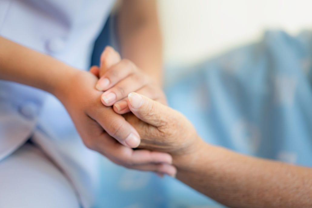 Nurse-sitting-on-a-hospital-be